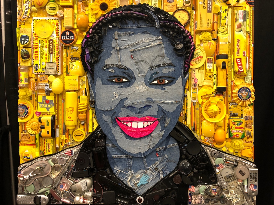 A photo of a mosaic of an African-American woman surrounded by yellow objects that represent her background.