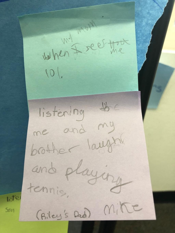 Written post-it with parent descriptions about what joy means to them