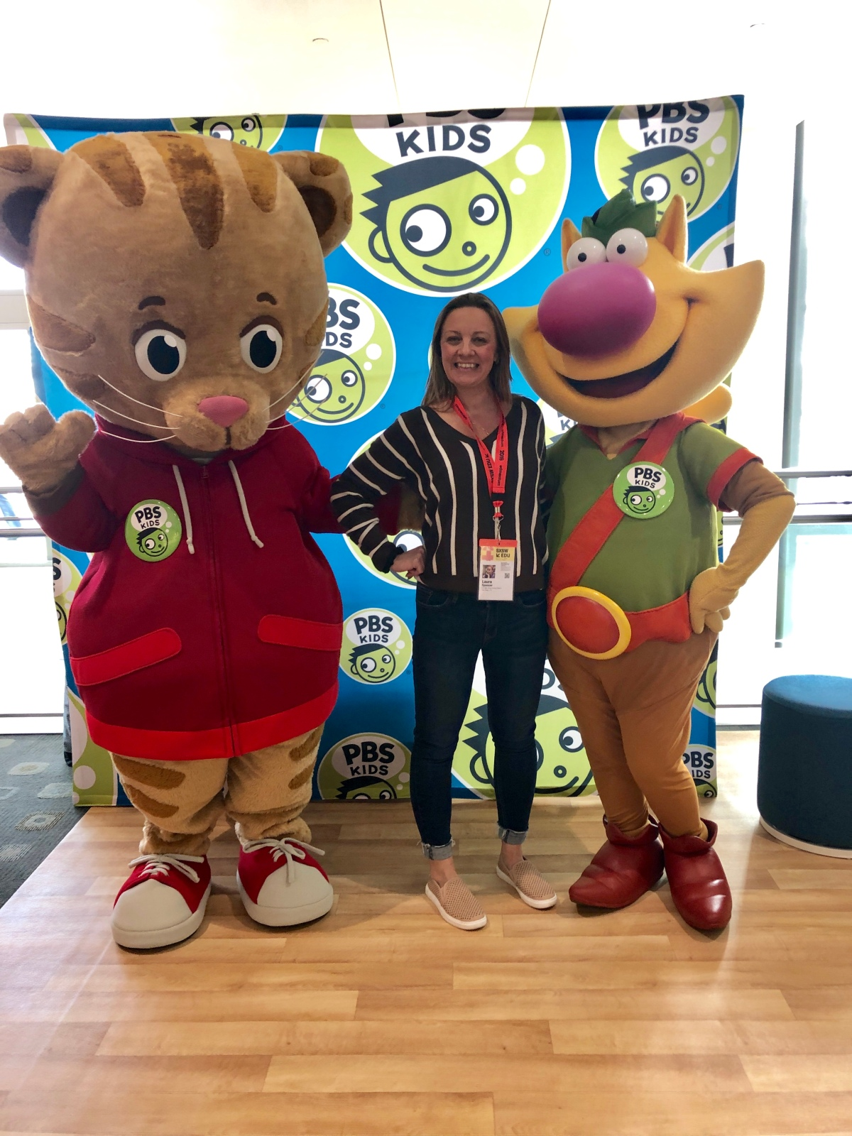 Laura with two PBS costumed characters