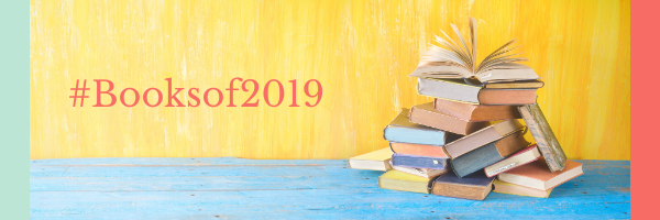 """Books in a pile with the top one open. Text says """"Booksof2019"""